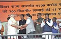 Narendra Modi being welcomed by the Union Minister for Road Transport & Highways and Shipping, Shri Nitin Gadkari at the dedication of the National Highway projects to the nation, at Ara, in Bihar. The Governor of Bihar.jpg