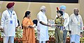 Narendra Modi giving away awards to the winners of national essay, painting and film competitions (3).jpg