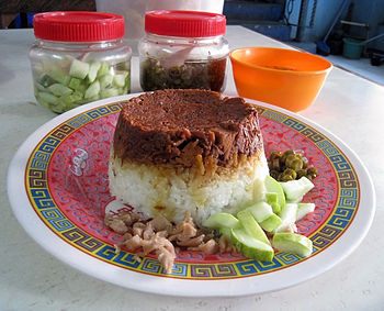 Nasi Tim Ayam (Steamed Chicken Rice) is a Chin...