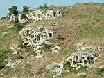 Rock caves on a hillside.
