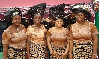 Folk costume - A group of African women wearing pagne.