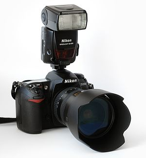 This image shows a Nikon D200 camera with a Ni...