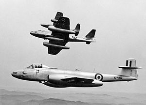 Three twin-engined, single-seat jet fighters in flight