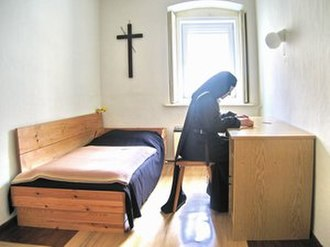 Christian prayer - A Carmelite nun meditating on the Bible