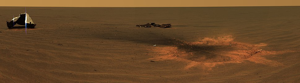 Area around the heat shield, including the resulting shield impact point. The heat shield was released before the rover landed and struck the surface on its own, and the rover later drove to the impact site. Near this location it discovered the first meteorite found on Mars, Heat Shield Rock