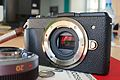 Panasonic Lumix DMC-GX1 body with 20mm f1.7 lens, Gordy's strap and Aki-Asahi leatherette.jpg