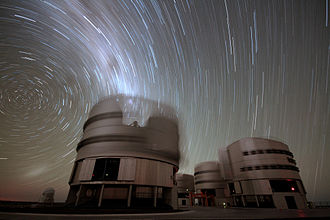 Long-exposure photography - In this 45-minute exposure taken on a dark clear night at Paranal Observatory, the stars leave trails as they appear to revolve around the south celestial pole (left), due to Earth's rotation.