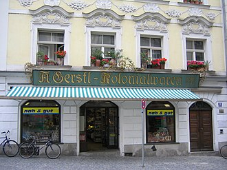 Colonial goods - A Colonial Goods shop photographed in Passau in 2005. (The modern logo in the windows indicate that the shop is now in some way part of or affiliated with the Edeka group.)