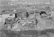 """Paterson, New Jersey - Textiles. Bachelor shacks in outskirts of Paterson, on """"Molly Jan Brook."""" About 20 men live... - NARA - 518622"""