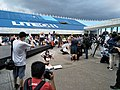 People photographing Youmi Wang kneeling 20200705a.jpg