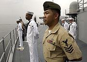 Personnel man the rails on USS Blue Ridge (LCC 19)