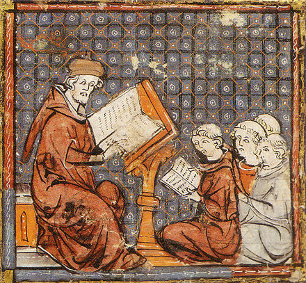 Teaching at Paris, in a late 14th-century Grandes Chroniques de France: the tonsured students sit on the floor. Philo mediev.jpg
