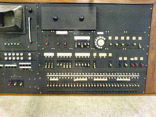 The Pilot ACE was a prototype of the ACE, which was the actual computer designed by Turing, but I couldn't, in a lazy Google search, find any pictures of the ACE.