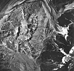 Plateau and Loomis Glaciers, outwash, glacial remnents, and dark moraines, August 24, 1963 (GLACIERS 5767).jpg
