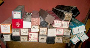 Piano roll - A stack of piano rolls, some in boxes, some not.