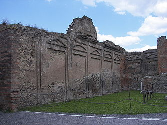 Pompeii Temple of Vespasian wall.jpg