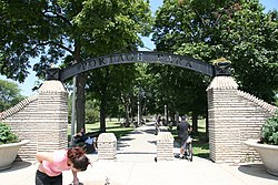 The southwestern entrance into Portage Park at the intersection of Irving Park Road and Central Avenue