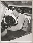 Portrait of Grace Cavanagh in an aircraft cockpit at Bankstown Aerodrome during the second Australian Women Pilots' Association Reliability Trials, Sydney, September 1954 (15667332484).jpg