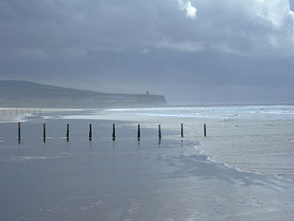 Portstewart - The Strand, looking west to the Barmouth and Mussenden Temple beyond.