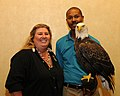 Posing for picture with Bald Eagle. (10594639434).jpg