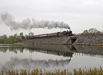 Midland Railway – Butterley - Preserved locomotive S&DJR 7F 2-8-0 No. 53809 crosses the Butterley Reservoir causeway