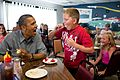 President Barack Obama shares his strawberry pie with a boy during a lunch stop.jpg