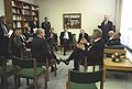 President Clinton holding an impromptu meeting with the government and negotiating team following a ceremony at Fort Myer, VA - Flickr - The Central Intelligence Agency.jpg