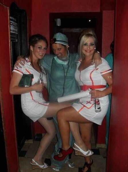 File:Pretty young woman in 'naughty nurse' uniform and sandals 03.jpg