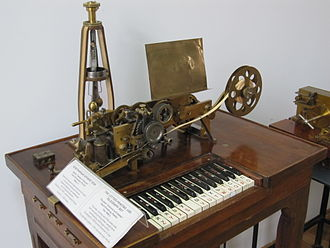 Teleprinter - Hughes telegraph, an early (1855) teleprinter built by Siemens and Halske. The centrifugal governor to achieve synchronicity with the other end can be seen clearly.