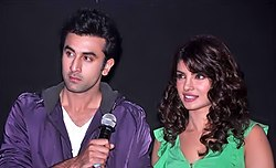 A photograph of Ranbir Kapoor and Priyanka Chopra looking from the camera
