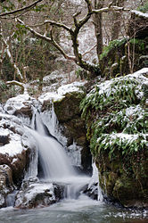 The Puits d'Enfer waterfall in the snow