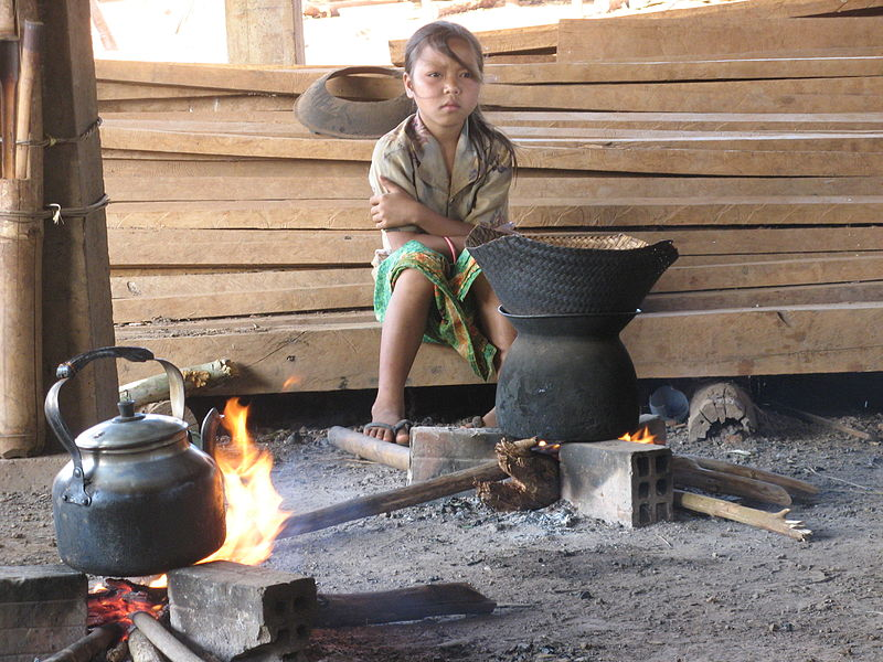 Girl next to cooking fire in Ratanakiri, Cambodia.