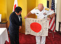 Rear Adm. James F. Caldwell returns a World War II Japanes flag. (9394574628).jpg