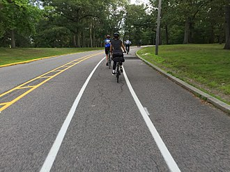 Roger Williams Park - New bike lanes in Roger Williams Park. Northbound car traffic on the far left, and separate lanes for runners, northbound cyclists, and southbound cyclists.