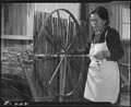 Rohwer Relocation Center, McGehee, Arkansas. A first generation mother learning to spin an old fash . . . - NARA - 538989.tif