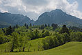 Rolling hills leading into the Piatra Craiului Mountains.jpg