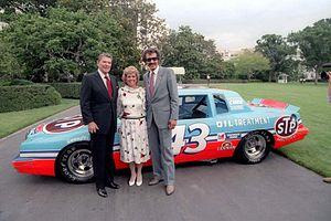 "NASCAR lore - Richard Petty, nicknamed the ""King of Stock Car Racing"" poses with President Ronald Reagan and Petty's wife, Linda. Petty won his record 200th NASCAR victory on July 4, 1984 at the Firecracker 400, with Reagan in attendance."