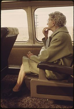 SCENERY ON THE SOUTHWEST LIMITED ATTRACTS AN ELDERLY PASSENGER ON AN AMTRAK TRAIN BETWEEN LOS ANGELES, CALIFORNIA... - NARA - 555975