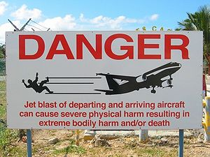 Aircraft spotting - Warning sign at Maho Beach for runway 10 approach to Princess Juliana International Airport.