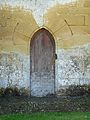 Saint-Geniès chapelle Cheylat porte.JPG