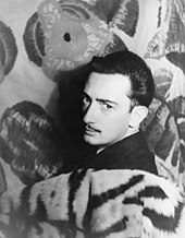 A grayscale 1939 photograph of painter Salvador Dalí