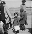 San Bruno, California. Family of Japanese ancestry arrives at assembly center at Tanforan Race Trac . . . - NARA - 537484.tif