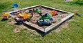 Sandbox with toys on Röe gård 2.jpg