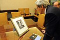 Secretary Kerry Examines the Portrait of a Relative Connected to the Philippines (11420586946).jpg