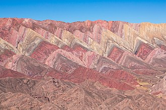 Andean orogeny - Tilted strata of the Yacoraite Formation at Serranía de Hornocal in northernmost Argentina. The Andean orogeny caused the tilting of these originally horizontal strata.