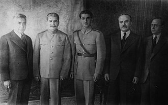 Tehran Conference - The Shah of Iran (center), pictured to the right of Joseph Stalin at the Tehran Conference (1943)