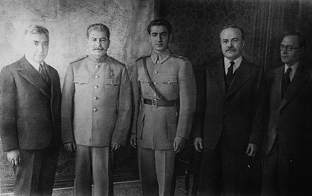 The Shah of Iran (center), pictured to the right of Joseph Stalin at the Tehran Conference (1943) Shahstalinmolotov.JPG