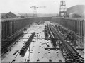 Shipbuilding Dock, general view looking south. Showing blocking of Ammunition Ships Nos. 1 and 2, also blocking of... - NARA - 299642.tif