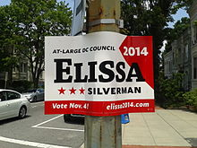 "A red and white sign with the name ""Elissa"" large and in black."