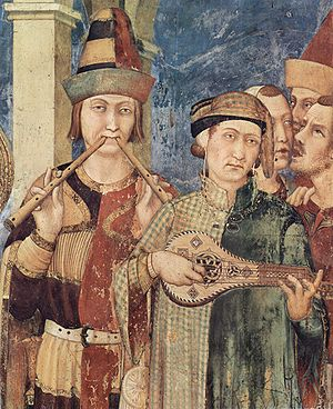 Gittern - Gittern (right) depicted in a c. 1322 fresco scene from the life of St. Martin of Tours. The instrument on the left is a set of aulos.